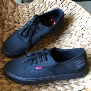 Black Levi's Sneakers. All black.